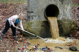 Woman Cleaning Stormwater Outfall